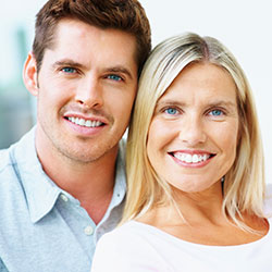Couple with dental veneers in lancaster