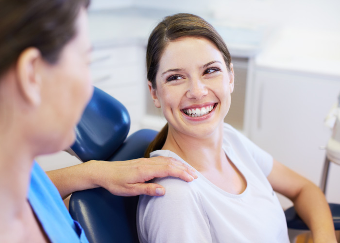 brunette woman in a dental chair at Michael Giovannini, DDS in Palmdale, CA