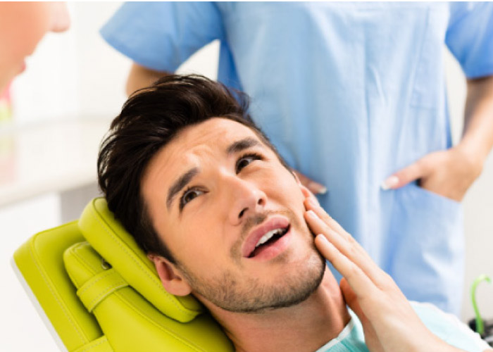 man in the dental chair waiting for a dental crown